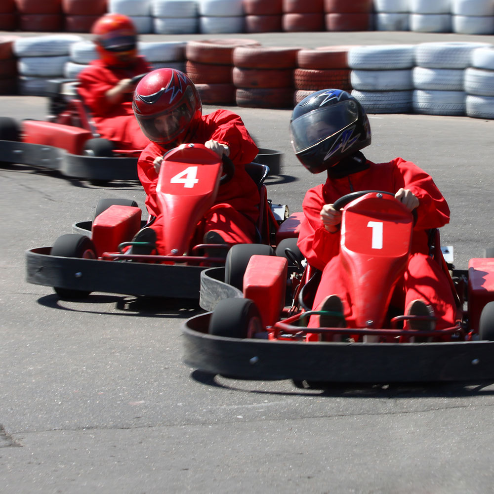 Three karts entering a corner in a go-kart race.